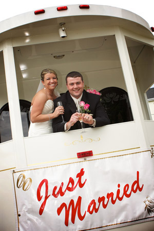 bridal couple on trolley just married